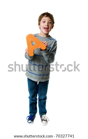 "little boy holding the letter ""A"""