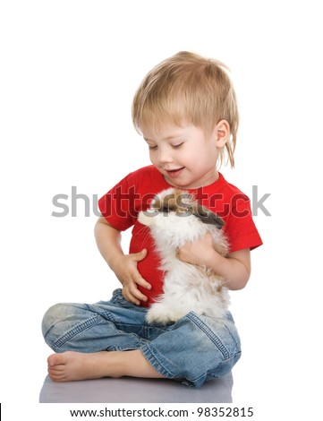 Little boy holding the small rabbit. isolated on white background - stock photo