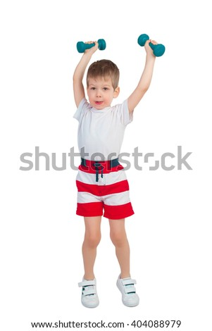 Little boy holding two blue dumbbells over head on a white background - stock photo