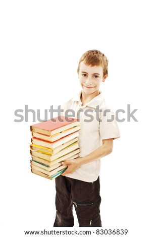 Little boy holds a stack of books. Isolated on white - stock photo