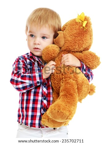 Little boy hugged a teddy bear.White background, isolated photo. - stock photo
