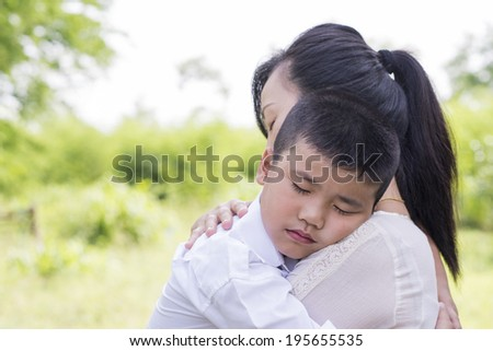 little Boy hugging his mother