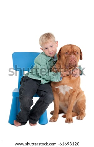 Little boy hugging its dog - stock photo