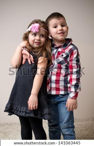 Little boy hugging little girl - stock photo