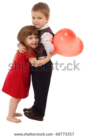 Little boy hugging little girl with red balloon, isolated on white - stock photo