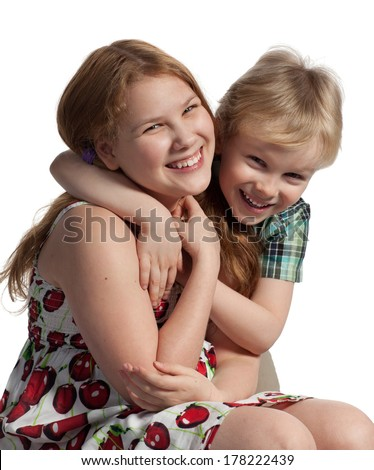 Little boy hugs his sister, isolated on white background. - stock photo