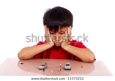 little boy imagining he is driving the toy car - stock photo