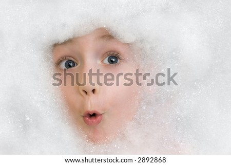 Little boy in a bath foam - stock photo
