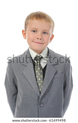 Little boy in a business suit. Isolated on white background