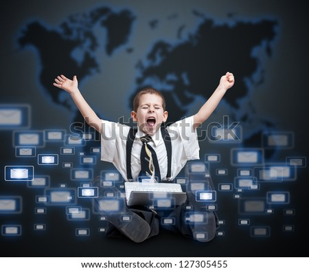 Little boy in a business suit receiving many email - stock photo