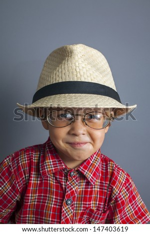 little boy in a cap and glasses - stock photo