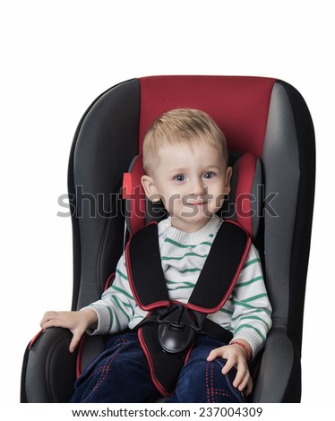 little boy in a  car seat on a white background - stock photo