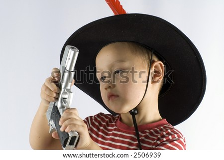 little boy in a cowboy hat and with gun