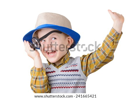 little boy in a hat and glasses laughing on white background - stock photo