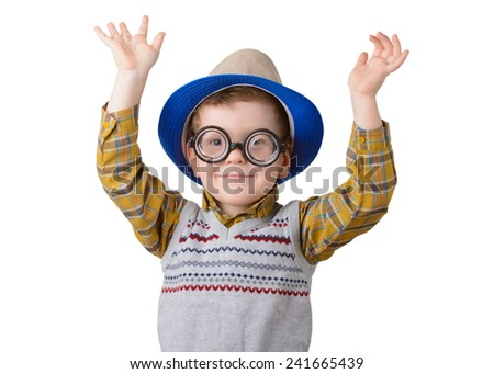 little boy in a hat and sunglasses with hands raised on white background - stock photo