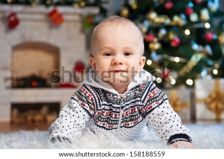 Little boy, in a holiday room - stock photo