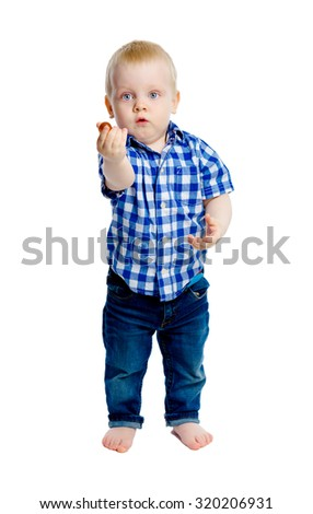 Little boy in a plaid shirt in full growth. White background. Studio - stock photo