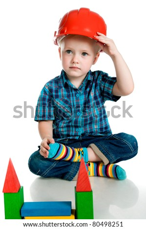little boy in a red construction helmet on white background - stock photo