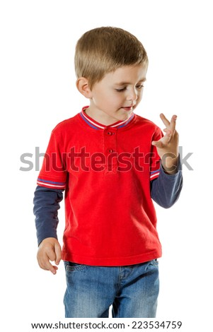 Little boy in a red sweater and blue jeans considers her fingers isolated on white background - stock photo
