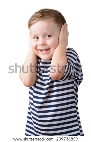 little boy in a striped vest with closed ears on a white background - stock photo