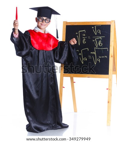 Little boy in academic hat doing complex math on black chalkboard. Isolated on a white background - stock photo