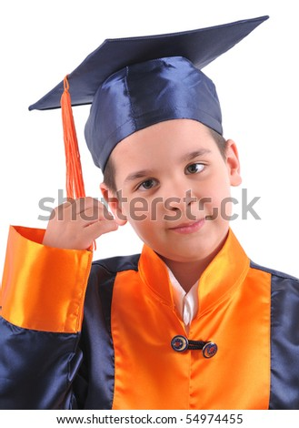 Little boy in cap and gown holding his tassel