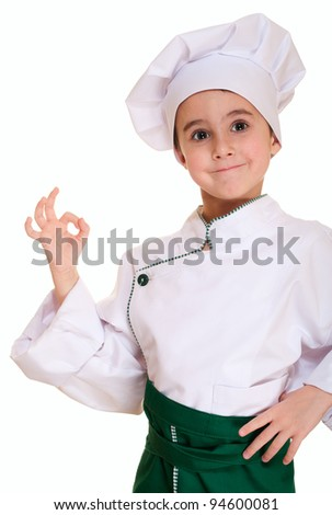 Little boy in chef uniform with ok sign isolated on white - stock photo