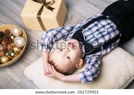 Little boy in Christmas decorations expect a miracle - stock photo