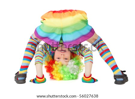 little boy in clown dress somersault isolated on white - stock photo