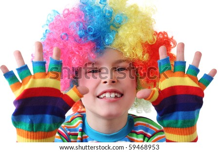 little boy in clown wig and multicolored gloves smiling and looking at camera, half body, isolated - stock photo