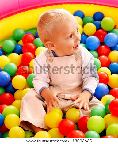 Little boy in colored ball. - stock photo