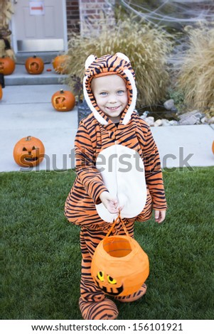 Little Boy in Costume Trick-or-treating on Halloween - stock photo