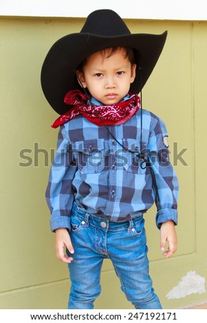 little boy in cowboy suit - stock photo