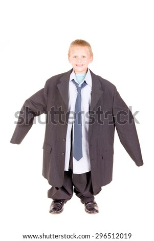 little boy in father suit isolated in white background - stock photo