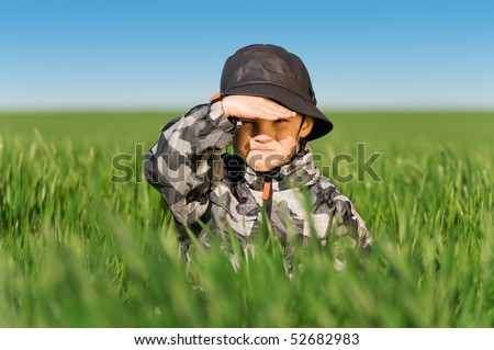 Little boy in field a bright spring's day - stock photo