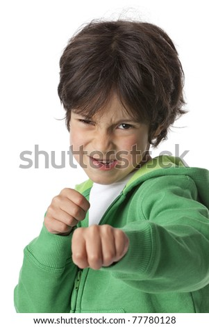 Little boy in fighting position on white background - stock photo