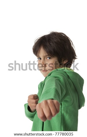 Little boy in fighting position on white background and negative space for text - stock photo