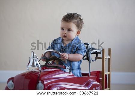little boy in fire truck - stock photo