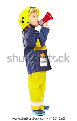 Little boy in fireman costume with megaphone isolated on white background