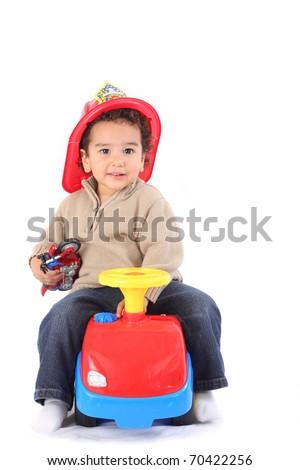 Little boy in fireman's helmet - stock photo