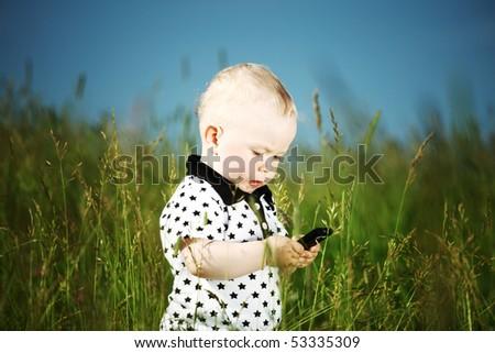 little boy in green grass - stock photo