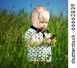 little boy in green grass call by phone - stock photo