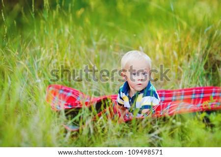 Little boy in green summer grass  outdoor - stock photo