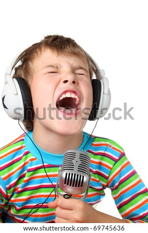 Little boy in headphone with microphone in hands sings with wide open mouth - stock photo