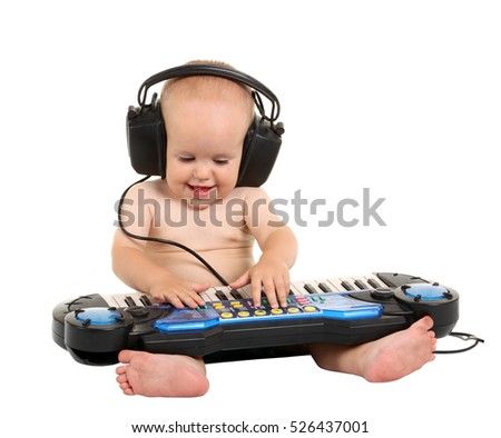 Little boy in headphones on the white background