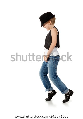 Little boy in jeans and hat is dancing