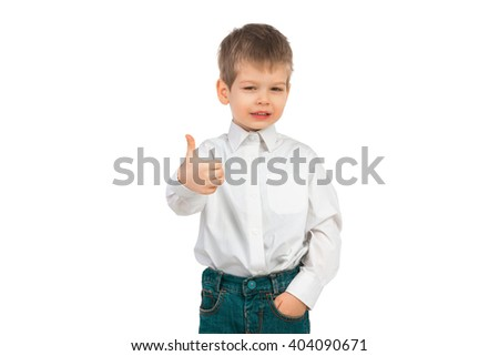 Little boy in jeans and shirt on a white background