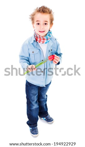 Little boy in jeans holding a tulip  - stock photo
