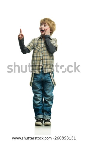 Little boy in jeans on the white background - stock photo