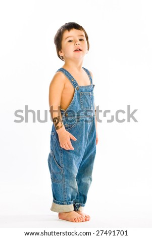 Little Boy in jeans on white - stock photo